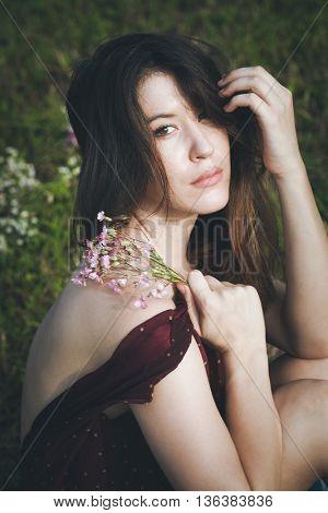 young gentle woman portrait in summer field