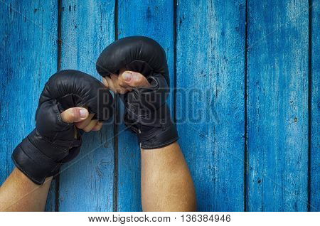 Two hands clenched in a fist gloves for boxing