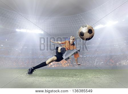 Soccer player with ball in action on field of stadium