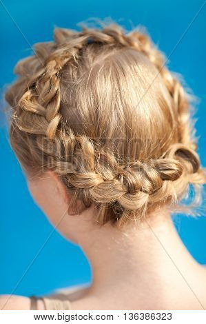 Female hairdress. Braids on the head of the girl.