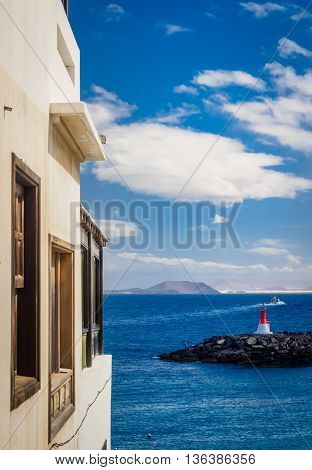 View of the ocean from the window of traditional house in Playa Blanca, Lanzarote, Canary Islands, Spain