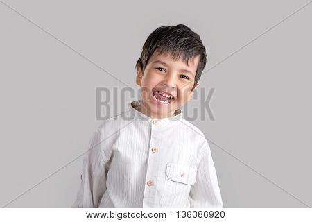 portrait of the boy  in white shirt smiles