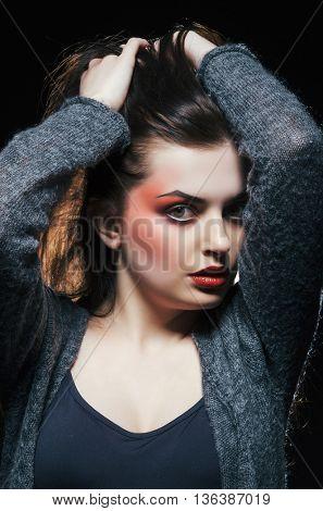 Woman with makeup. Studio portraits in dark.