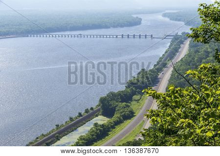 A scenic view of the Mississippi River with a lock and dam.