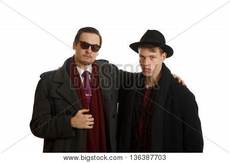 Two young men wearing stylish clothes on white background