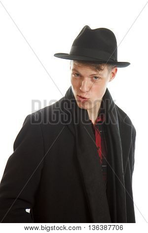 A charming young man in a coat and with a fedora