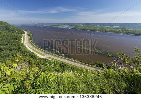 A scenic view of the Mississippi River with road and railroad tracks