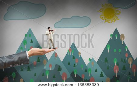 Big female palm holding small confident businessman that play violin