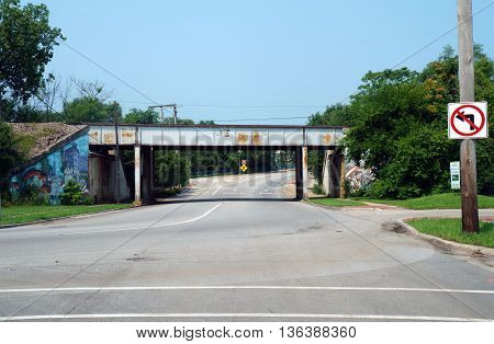 JOLIET, ILLINOIS / UNITED STATES - JUNE 30, 2015: A railroad bridge crosses over Columbia Street near downtown Joliet.