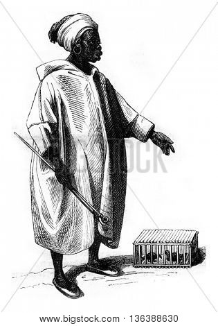 Negro bird merchant, vintage engraved illustration. Magasin Pittoresque 1843.
