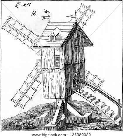 Windmill in use in the sixteenth century, vintage engraved illustration. Magasin Pittoresque 1852.