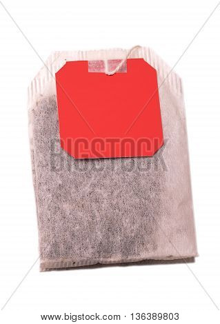 Teabag with red label. Top view. Isolated on a white. with clipping path
