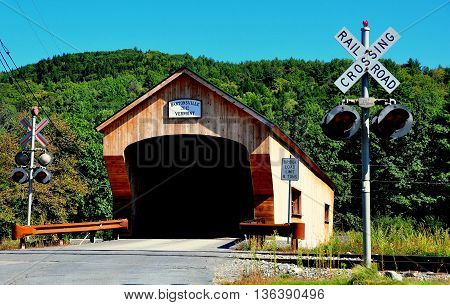 Bartonsville Vermont - September 19 2014: Bartonsville Covered Bridge a 151 foot long span over the Williams River is a replica of the original 1870 bridge destroyed during Hurricane Irene *