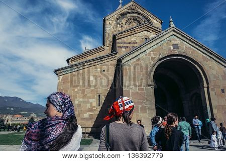 Mtskheta Georgia - April 26 2015. Tourists and local residents in front of Svetitskhoveli Cathedral (english - Cathedral of the Living Pillar) in Mtskheta one of the oldest cities of Georgia