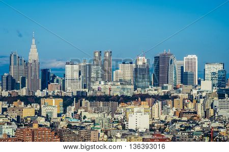 Tokyo Japan - February 27 2015. Tokyo skyline - view of the modern buildings of the Nishi Shinjuku district in capital of Japan