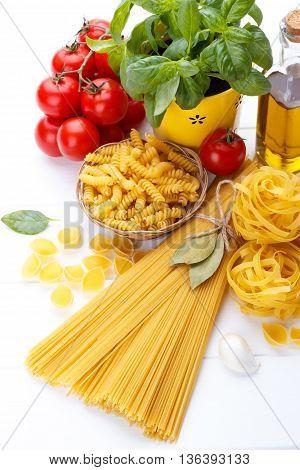 Italian Food Pasta Ingredients,basil,tomato,olive Oil On White Wooden Background