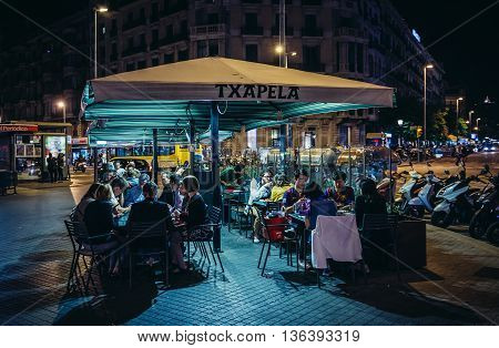 Barcelona Spain - May 23 2015. People sits at outisde tables of one of the restaurant at Catalonia Square