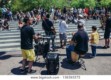 Barcelona Spain - May 24 2015. People listen to music performed live by street musicians in Port Vell district