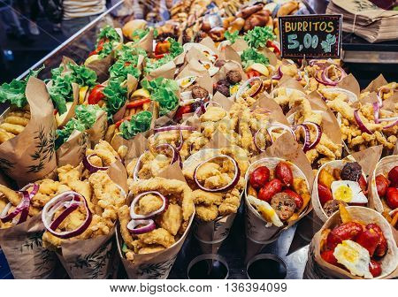 Barcelona Spain - May 28 2015. A stand with burritos at market called La Boqueria foremost tourist landmarks in Barcelona