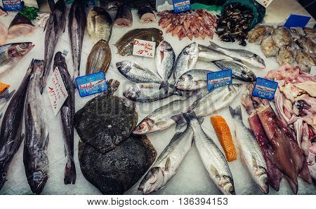 Barcelona Spain - May 28 2015. Fish stand at market called La Boqueria foremost tourist landmarks in Barcelona