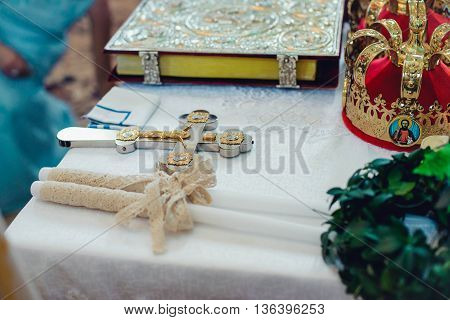 Wedding ceremonial attributes are on the altar in a church