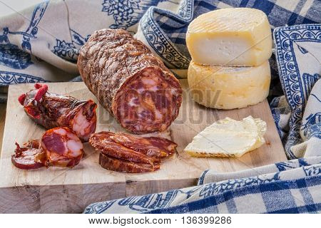 table of portuguese entries cheese portuguese sausages on wood background