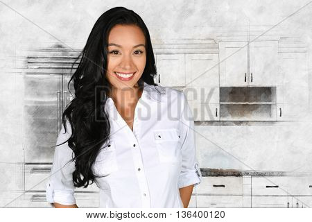 Happy young woman standing in her kitchen