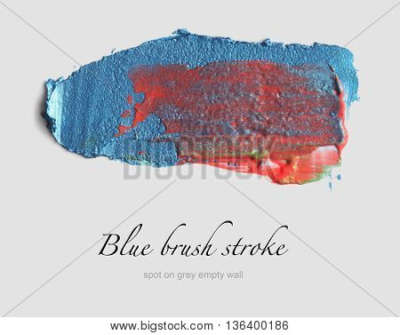 blue brush stroke on gray empty wall