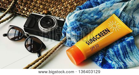 Packing Beach Camera Sunscreen Concept