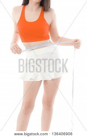 Young Asian woman measuring waist on white backgroundisolated