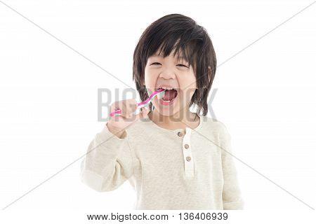 Cute asian child brushing teeth on white background isolated