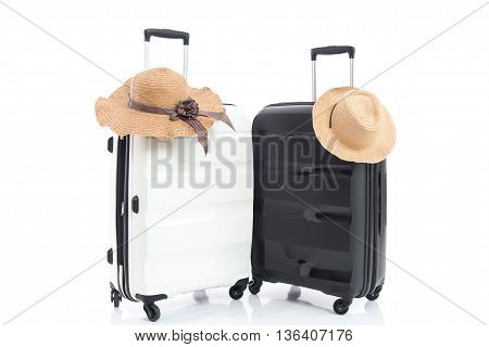 Two travel bags and straw hat on white background isolated