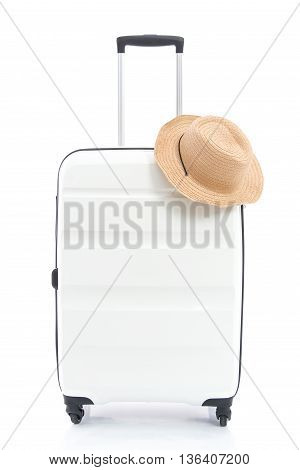 White travel bag and straw hat on white background isolated