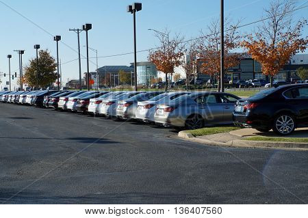 NAPERVILLE, ILLINOIS / UNITED STATES - NOVEMBER 3, 2015: Rows of brand new luxury vehicles are available for purchase on the lot at Lexus of Naperville.