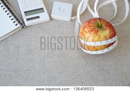 Apple tape measure notebook and calculator background for diet plan weightloss plan