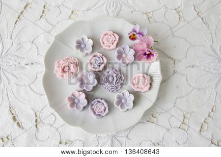 Pastel pink purple flower coconut jelly on vintage plate