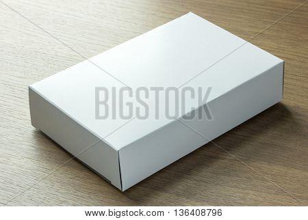 Blank White Paper Box On Dark Wood Background