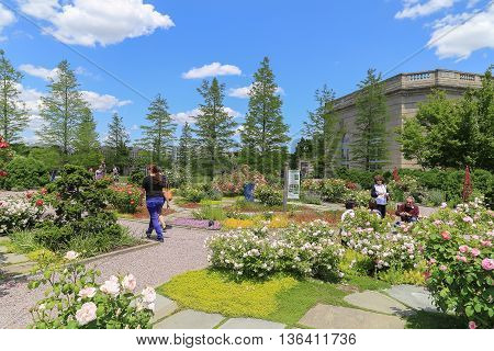 Washington DC USA - May 19 2014: Outdoor of national garden in Botanic Garden with blue sky and cloud. People walking around to see the difference kinds of tree and flower.