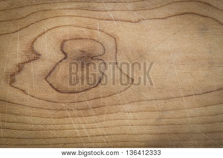 Background of close focus on used wooden cutting board with slightly scratches from knife