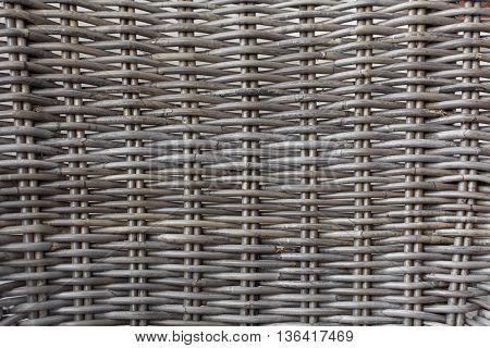 Rattan made from wood, Touching the surface of the tendon rattan, the brown wooden texture of rattan with natural patterns, gray rattan weave for closeup textured background