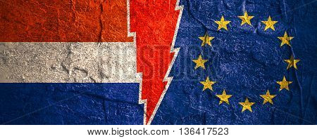 Image relative to politic relationships between European Union and Netherlands. National flags divided by high voltage sign. Concrete textured