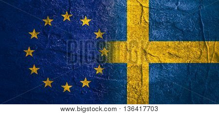 Image relative to politic relationships between European Union and Sweden. National flags textured by concrete