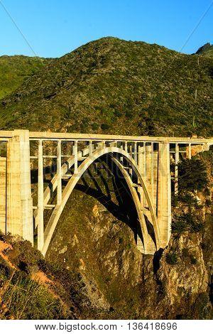 The Bixby Creek bridge in Big Sur near Monterey California during the evening golden hour