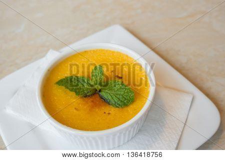 Custard pudding in white plate