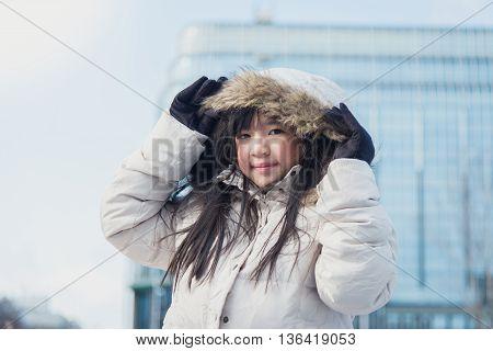 Beautiful asian girl in winter coat ourdoors