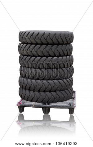 Tires on a plastic pallet isolated on white background. This have clipping paths