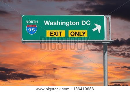 Washington DC exit only 5 freeway sign with sunrise sky.