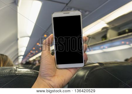 Woman Using Smartphone At The Plane  - Blurry Background