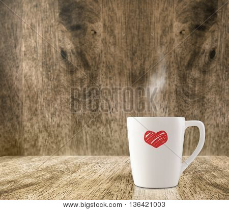 Hot White Coffee Cup With Red Heart On Wood Floor And Blur Wood Room,leave Space For Adding Content