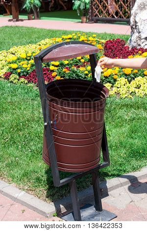 rubbish bin on the street on a background of grass.